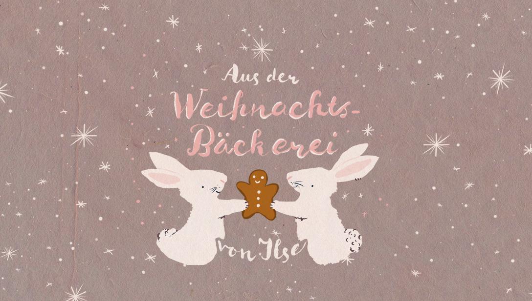 2 Hasen teilen sich einen Lebkuchenmännchen, umgeben von Sternen